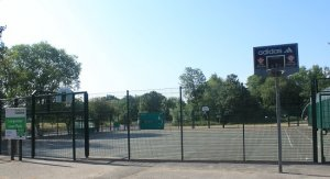 a fenced hard surface for fotball and basketball