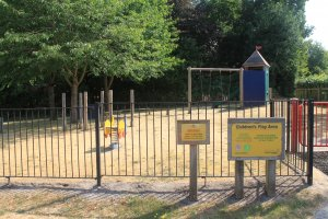 fenced playground with equipment